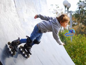 boy inline skating on ramp